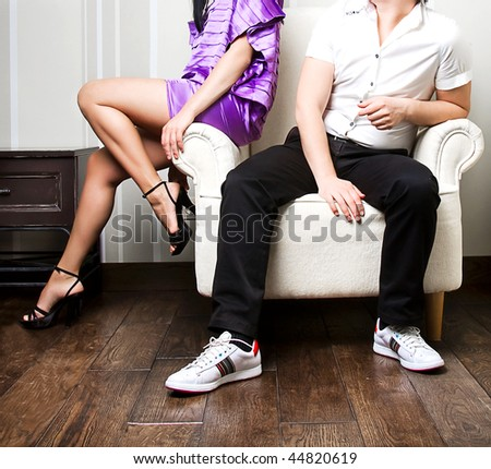 man and women relaxing on the sofa together - stock photo