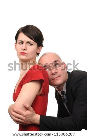 Man apologizes to woman isolated on white background. - stock photo