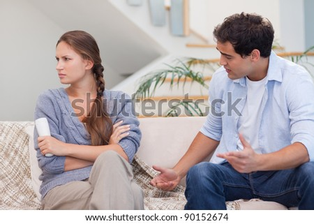 Man arguing with his wife in their living room
