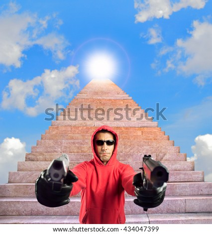 man armed with two guns guarding the stairway to heaven success - stock photo