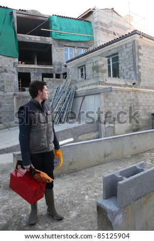 Man arriving at building site