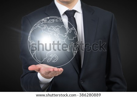 Man as if holding shining image of Earth on hand. Breast view. Concept of mental activity. - stock photo