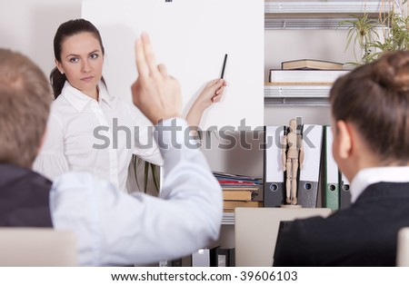 man asking a woman during conference in office - stock photo