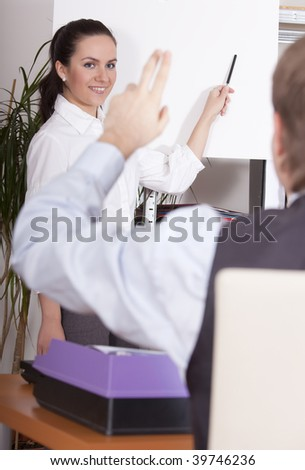 man asking woman by conference in a office - stock photo