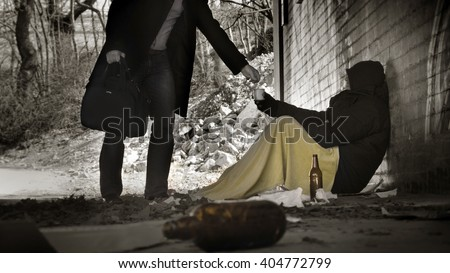 Man asks for charity - homeless  - stock photo