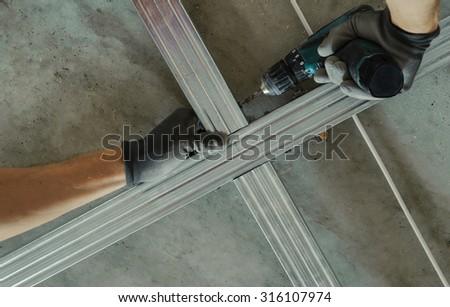 Man Assembles Profile Metal Frame Plasterboard Stock Photo (Royalty ...