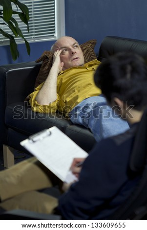 Man at a therapy session talking about his problems - stock photo
