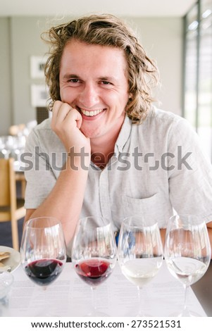 man at a wine tasting - stock photo
