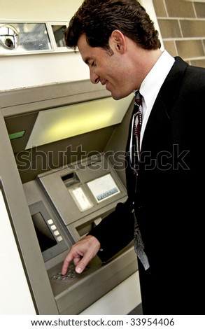 man at automatic teller machine