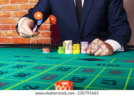 Man at casino - stock photo