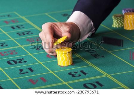 Man at casino - stock photo