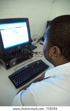 Man at computer - stock photo