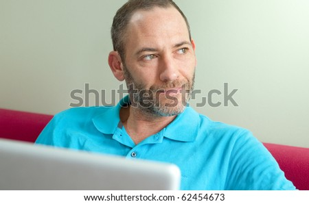 man at home with laptop - casual