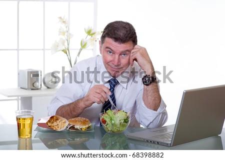 man at office eat green salad healthy food - stock photo
