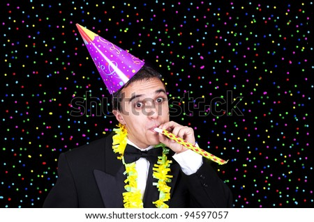 man at party under falling confetti - stock photo