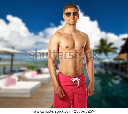Man at poolside jetty at Seychelles. Collage. - stock photo