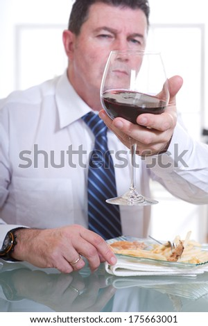 man at restaurant with red wine - stock photo