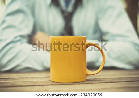 Man at table and drinking coffee  - stock photo