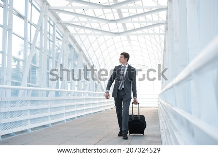 Man at the Airport with Suitcase