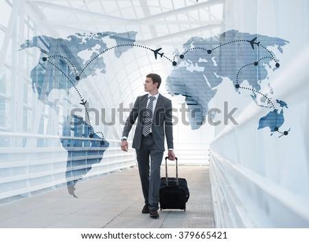 Man at the Airport with Virtual Worldmap - stock photo