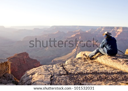 Man at the Grand Canyon looking at the great view - stock photo