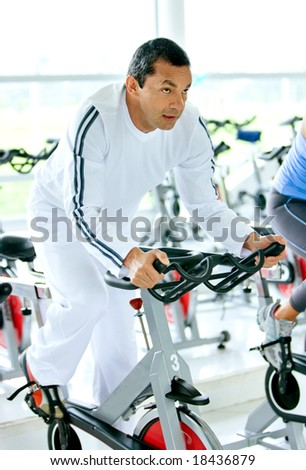 man at the gym doing cardio exercises - stock photo