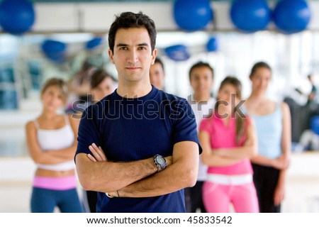 Man at the gym with a group behind her