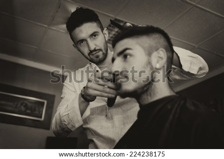 Man At The Hair Salon Situation - Handsome Young Hairdresser Giving A New Haircut To Male Customer At Parlor