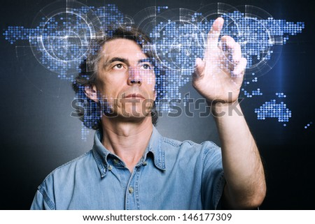 man at the screen with a map. - stock photo