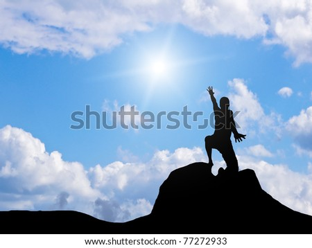 man at the top of the mountain against the sky