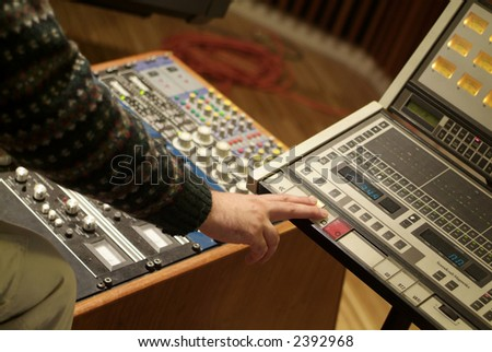 Man at work on a Audio Mixing Console - stock photo