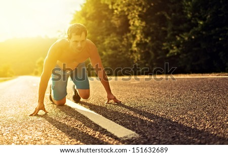 man athlete running on the nature at sunset outdoors - stock photo