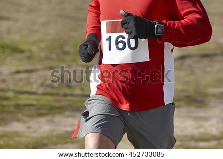 Man athletic runner on a countryside race. Outdoor circuit. Horizontal