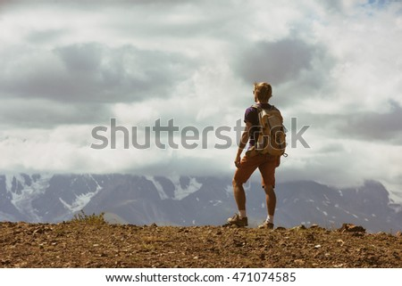 Man backpacker mountains concept
