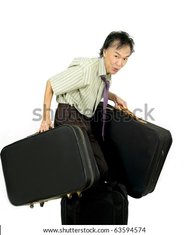 man baggage handling carrying large suitcases . white studio background - stock photo