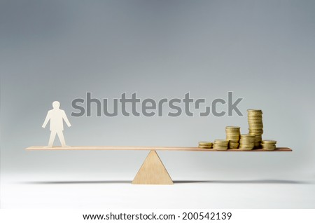 Man balanced on seesaw over a stack of coins