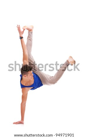 Man Balancing on One Hand on white background. young dancer standing on one of his hands - stock photo