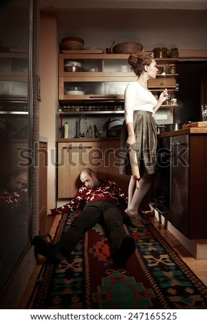 Man beaten by his wife in kitchen to a death - stock photo