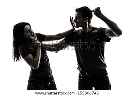 Man beating up woman, concept image of domestic violence - stock photo