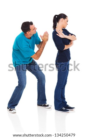 man begging his angry wife over white background - stock photo