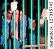 Man behind bars - stock photo