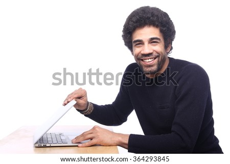 Man behind his computer - stock photo