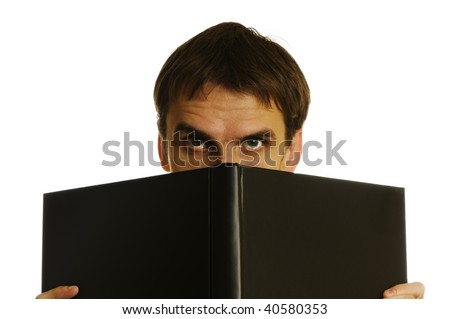 man behind the open book on white background