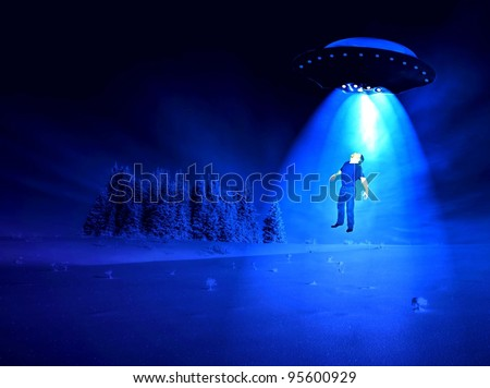 Man being abducted by aliens on a winter night.