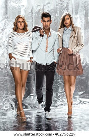 Man being adored by two glamorous women - stock photo