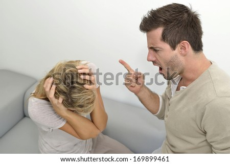 Man being angry at woman and using violence - stock photo