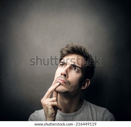 man being doubtful about something  - stock photo