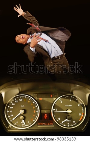 man being run over by a speeding car - stock photo