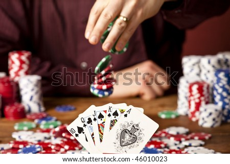 man betting against full house, focus on the cards - stock photo