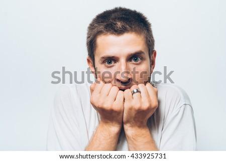 man bites his nails - stock photo